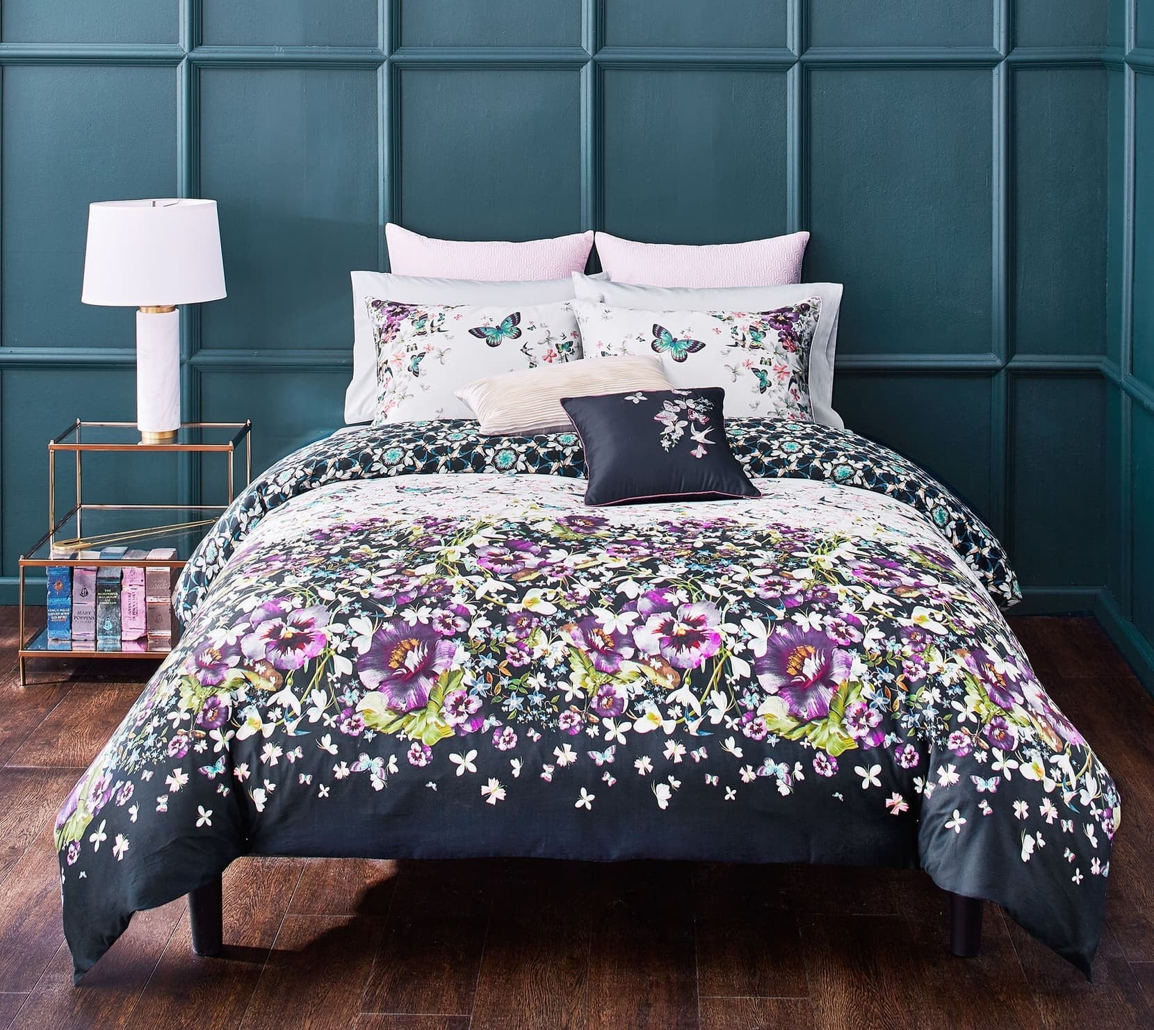 The comforter set in a pansy and butterfly pattern