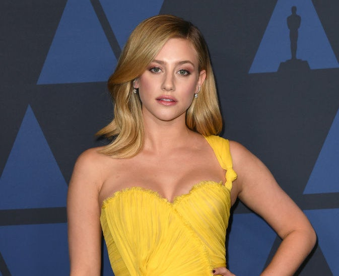 Lili Reinhart poses in a flowing gown at the Oscars