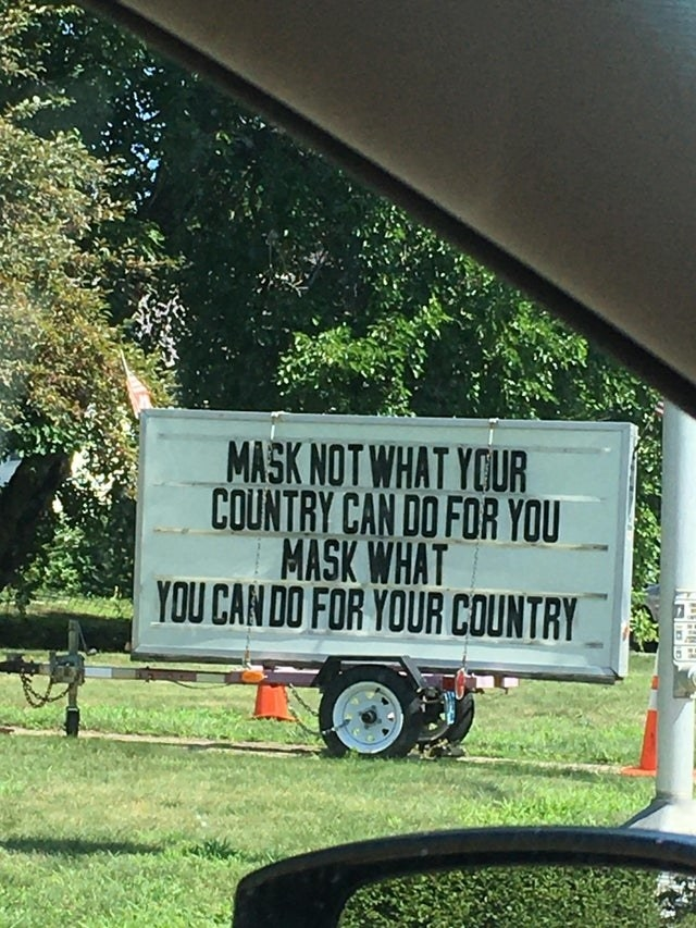 """sign reading """"Mask not what your country can do for you. Mask what you can do for your country"""""""
