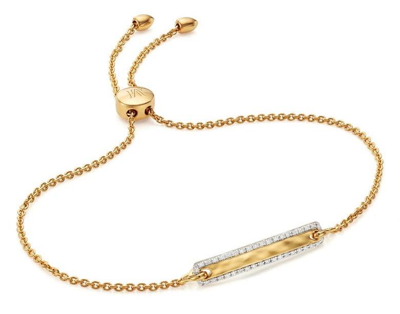 The gold bar bracelet with an adjustable slide closure