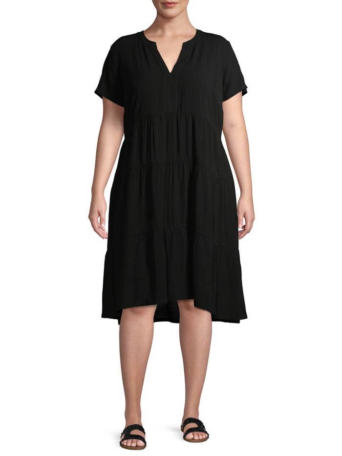 model in a v-neck black dress