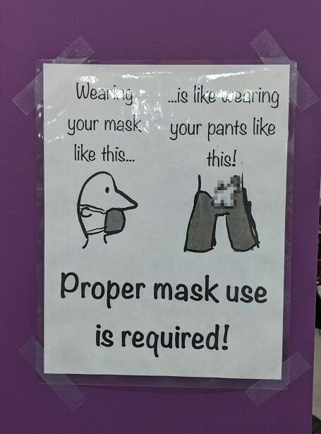 sign with a person wearing a mask below their nose that says wearing a mask like that is like wearing pants with your dick out