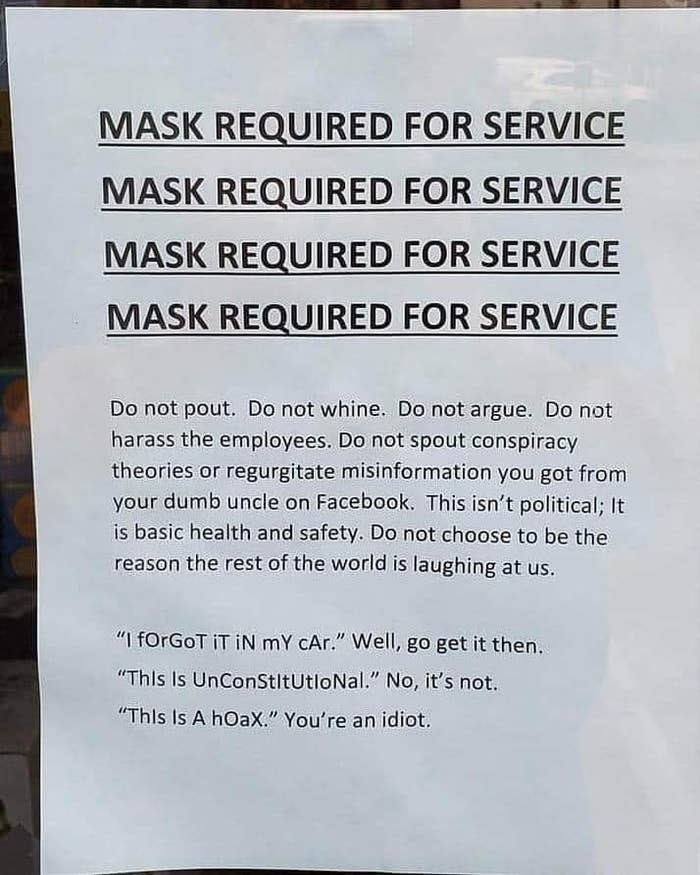 sign reading do not pout do not whine do not argue do not spout conspiracy theories this isn't political it is basic health and safety