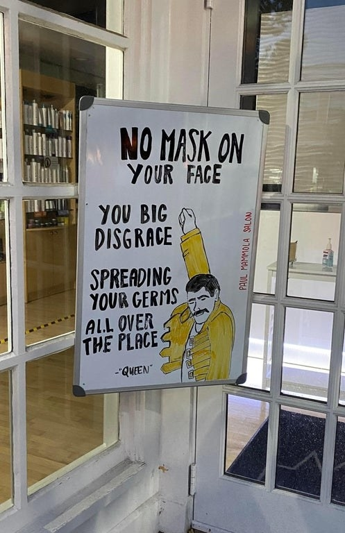 drawing of freddie mercury and it says no mask on your face you big disgrace spreading your germs all over the place