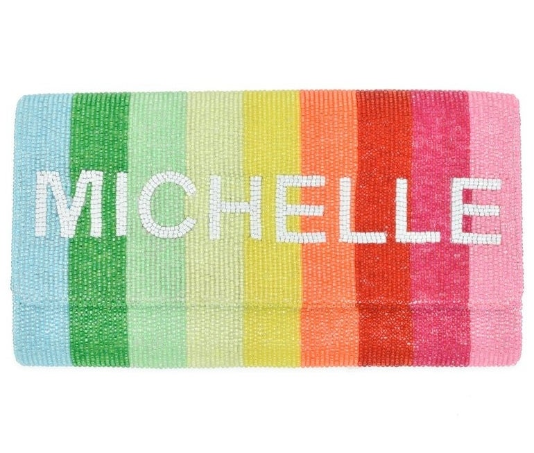 """The rainbow striped clutch with the name """"Michelle"""" worked into the beading in white letters"""