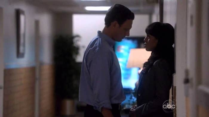Fitz and Olivia alone in the hallway, looking intensely into each other's eyes.