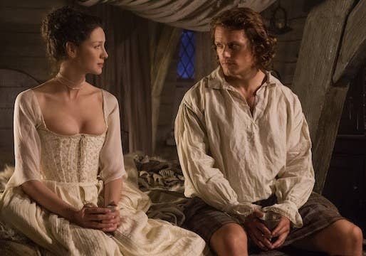 Claire and Jamie sitting on their marriage bed.