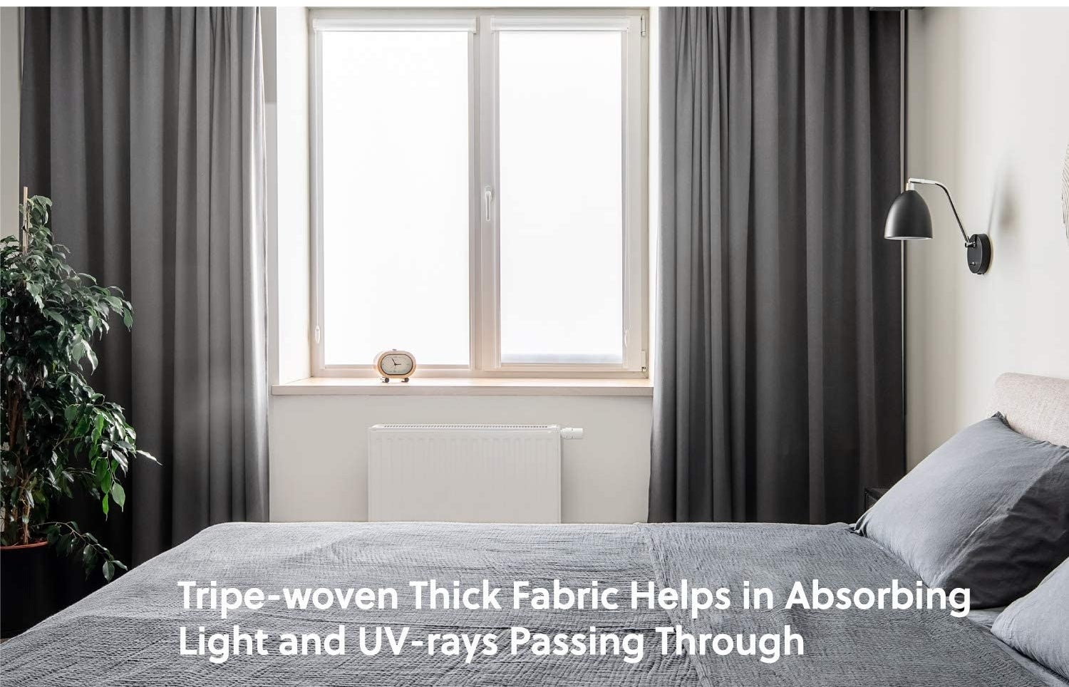 Curtains hanging in a bedroom with a window letting in sunlight