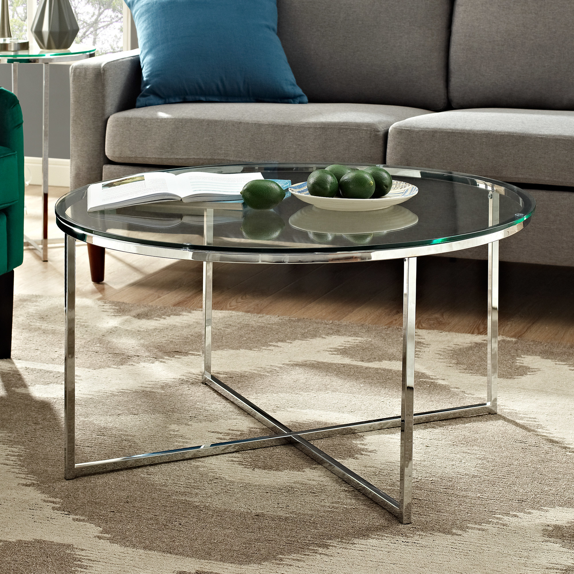 the chrome and glass rounded coffee table