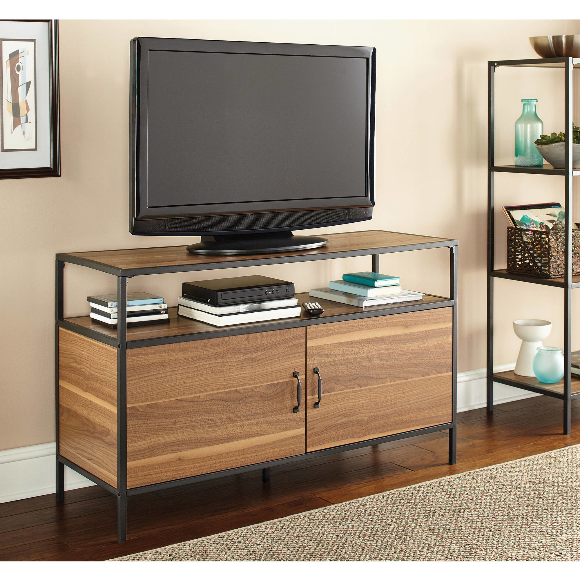 the tv stand with two cabinets and a shelf