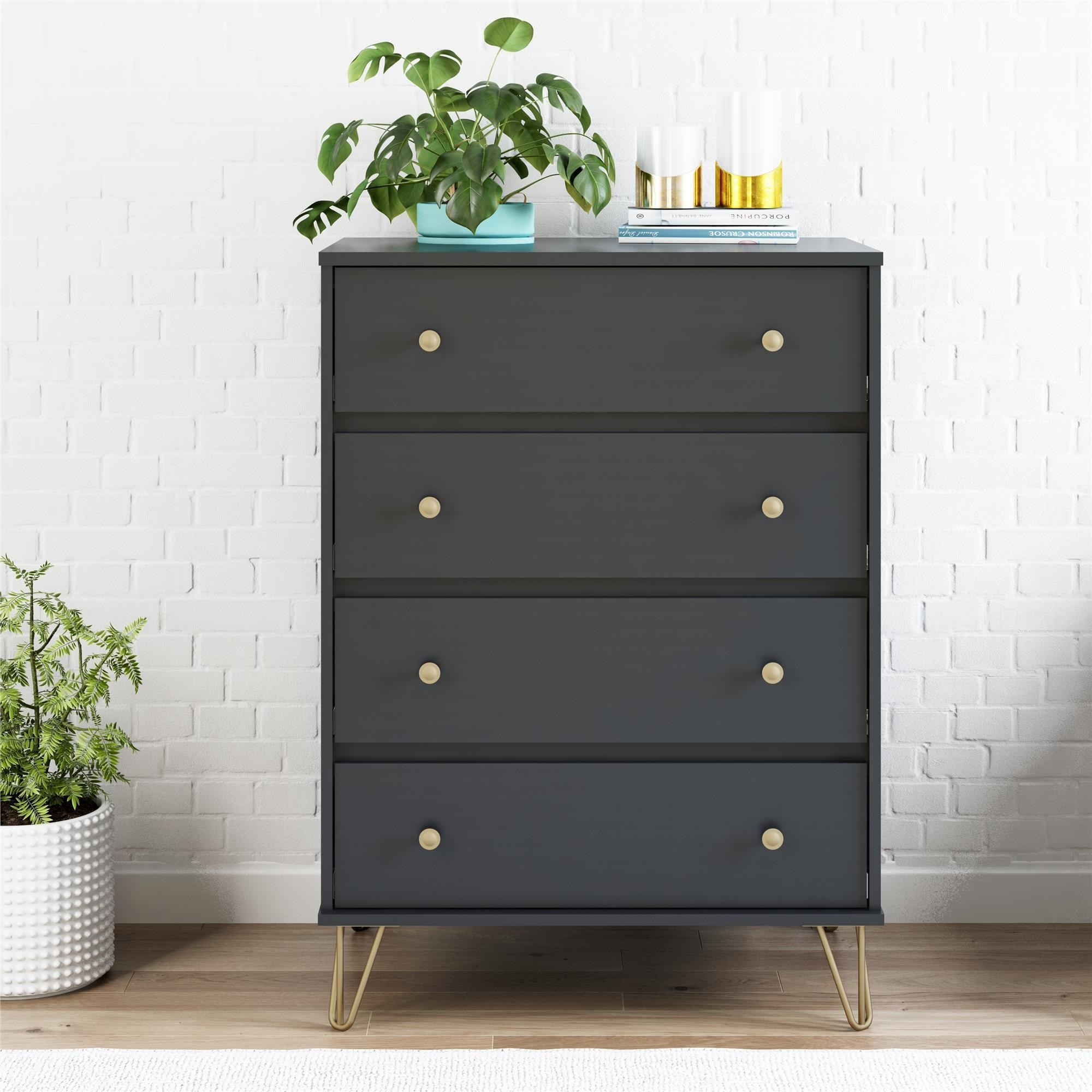 a black standing dresser with four drawers