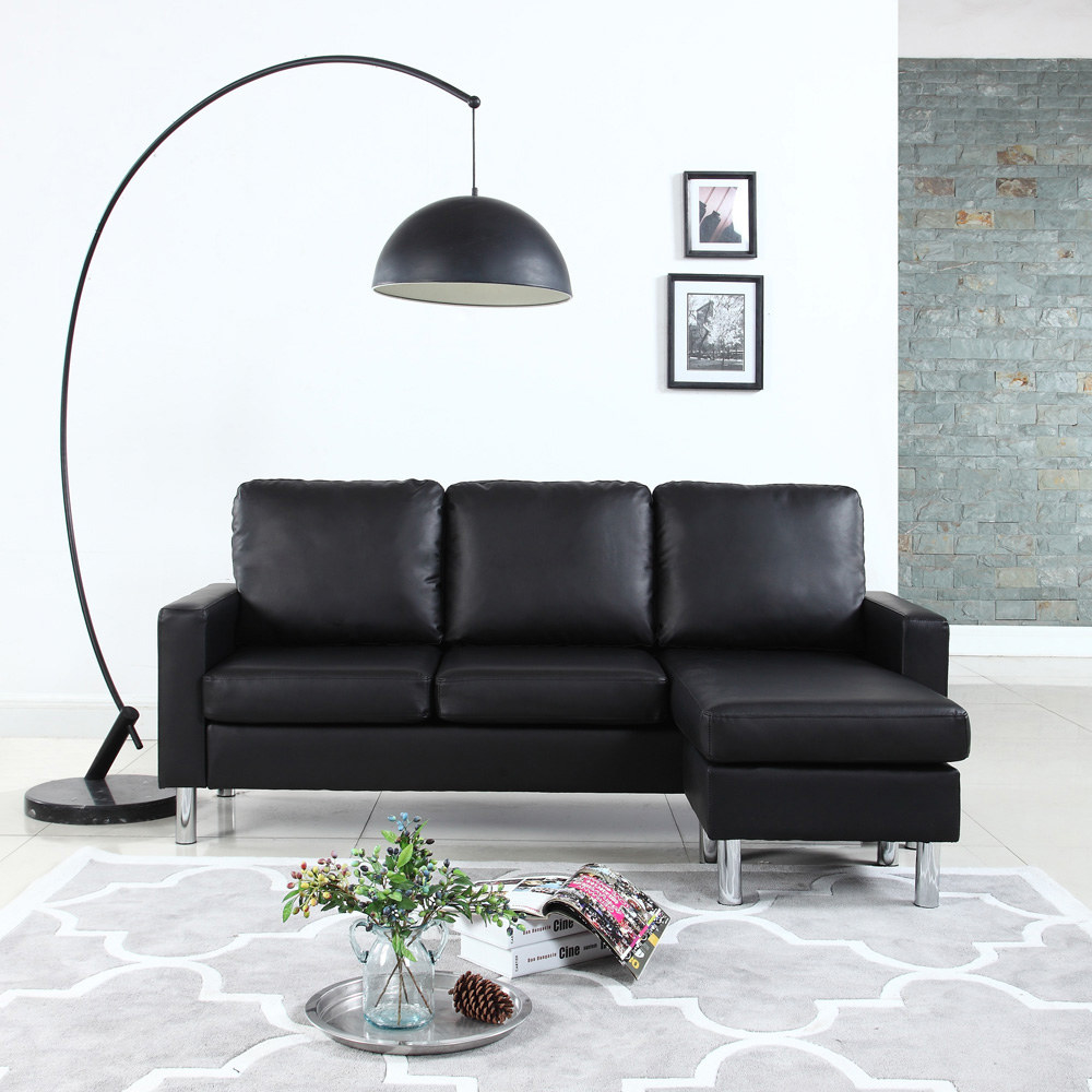 the black faux leather couch with an attached lounge