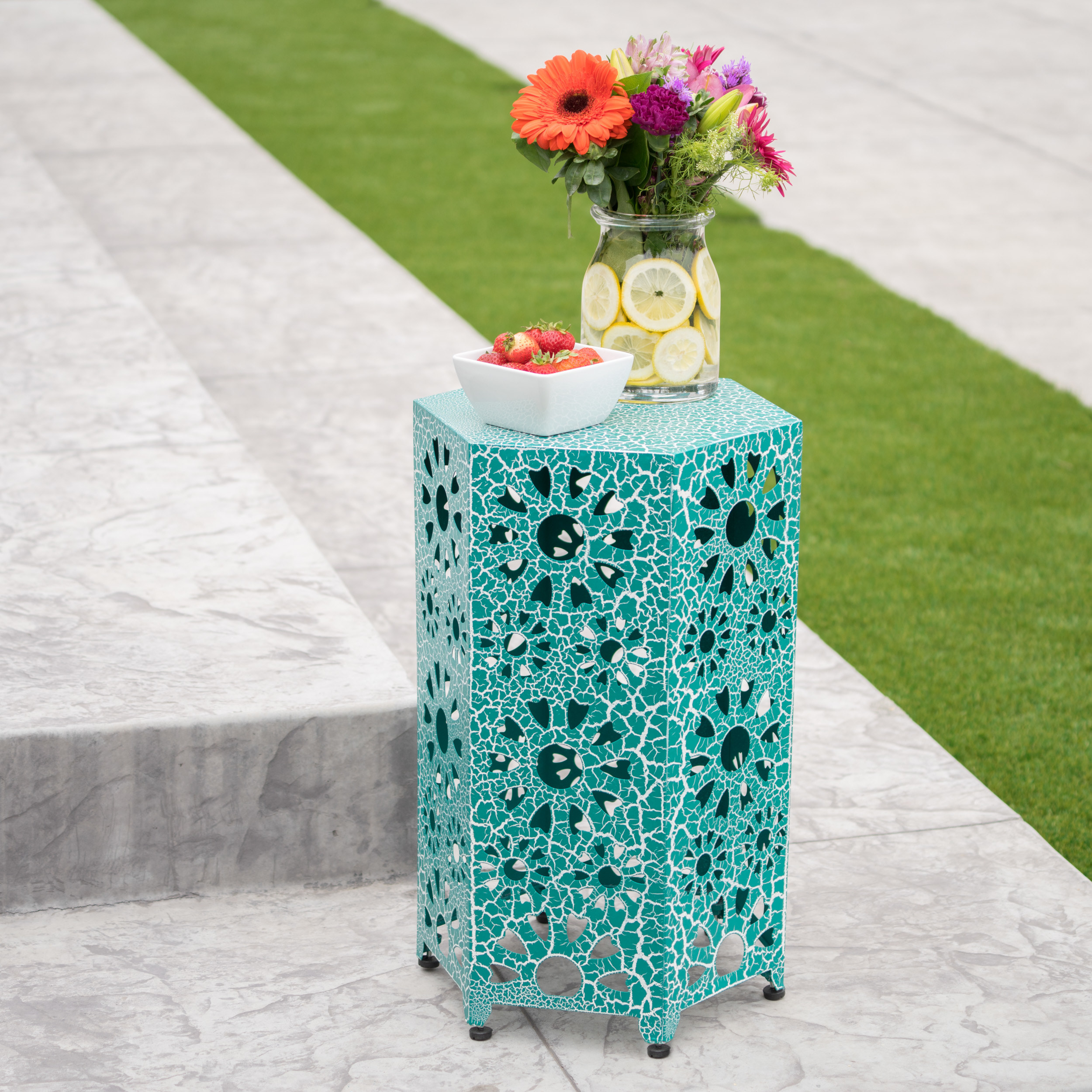 a turquoise table with sun-like cut outs throughout