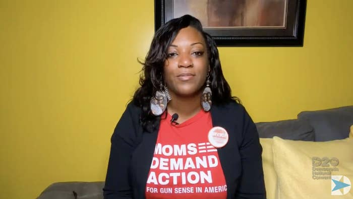 "DeAndra Dycus addresses the DNC from home wearing a red ""Moms Demand Action"" T-shirt"