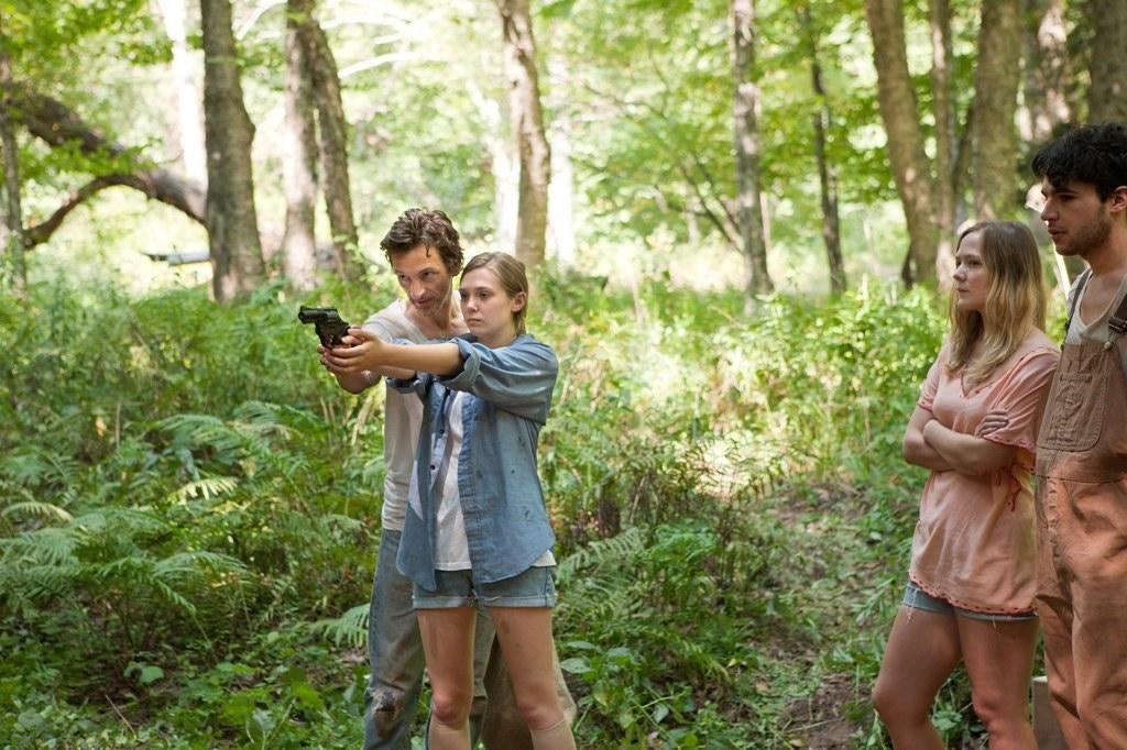 """John Hawkes and Elizabeth Olsen in """"Martha Marcy May Marlene."""""""