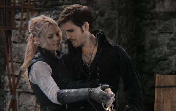 Emma behind Hook pulling out his sword