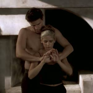 Angel behind Buffy holding her hands