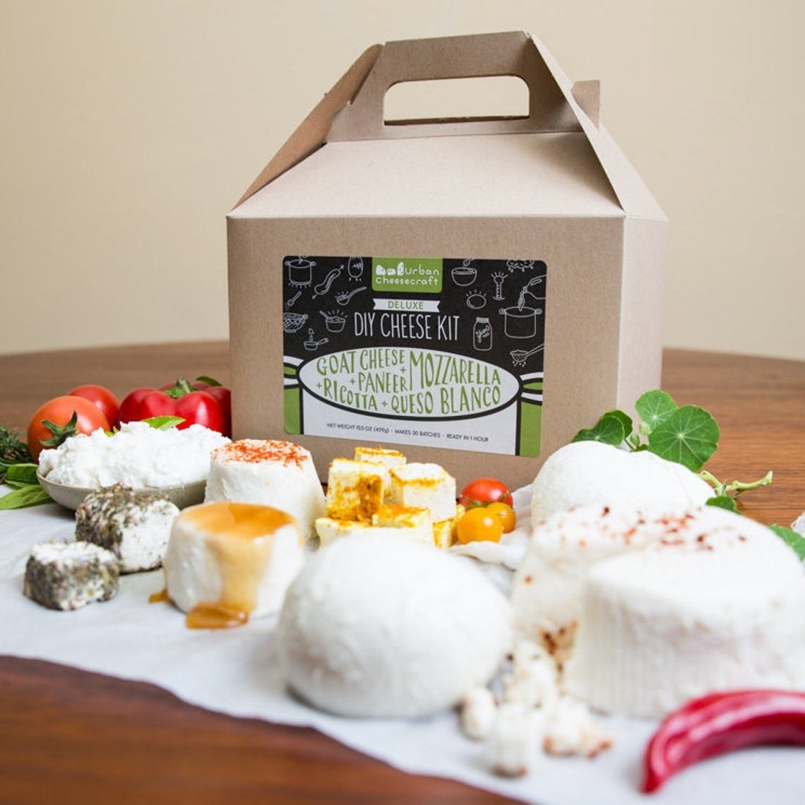 DIY cheese kit box with several types of cheese on a table