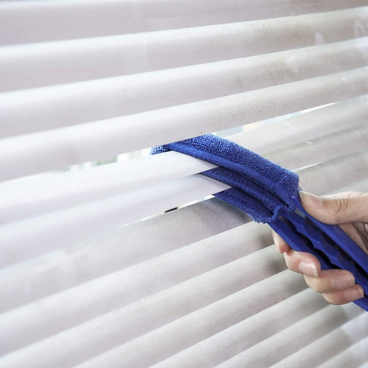 cleaner being used on blinds
