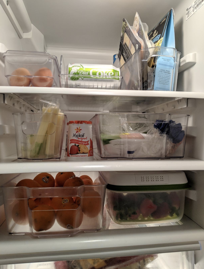 reviewer's fridge with food organized in each shelf