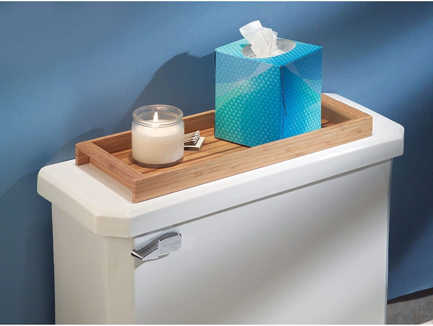 A wooden tray sitting on a toilet tank