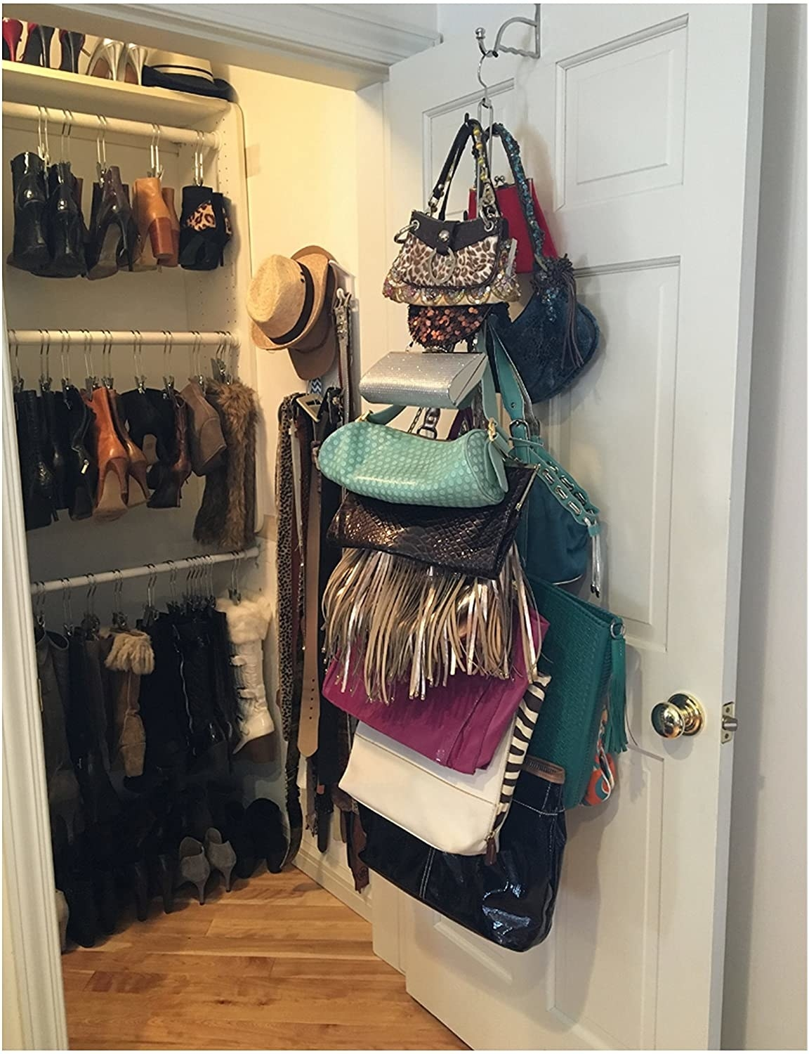 the hanger holding around 15 purses from the back of a closet door