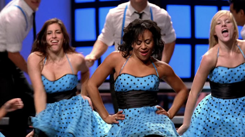 Vocal Adrenaline wearing cute polka dot dresses