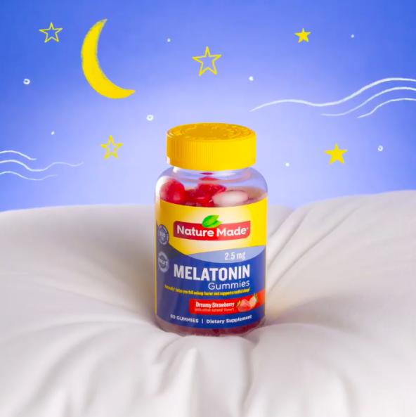strawberry melatonin gummies on a pillow