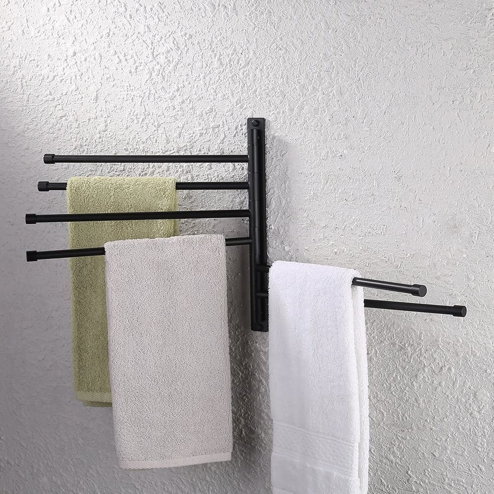 A metal towel rack with six bars Three bars have towels hang from them