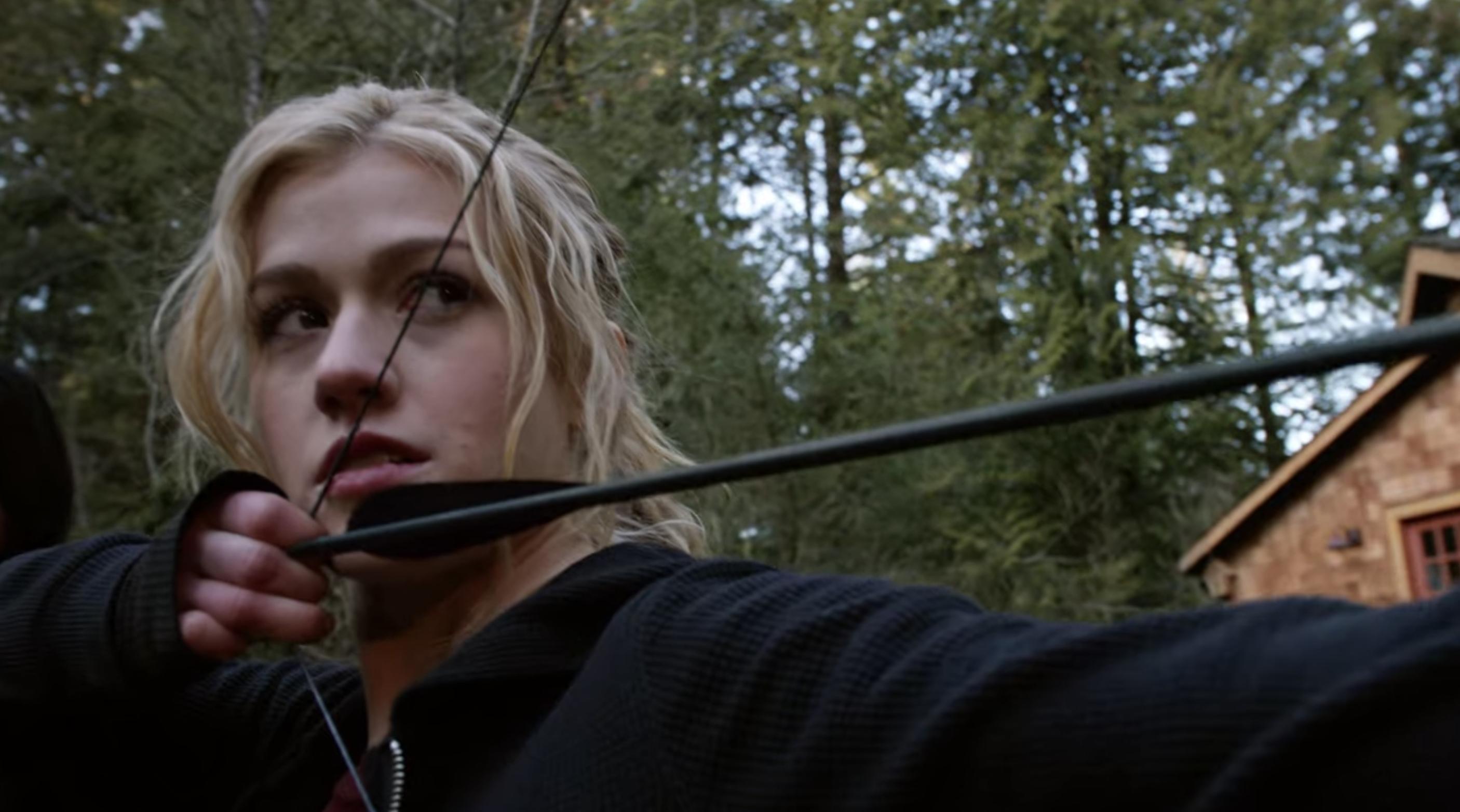 Mia shooting an arrow
