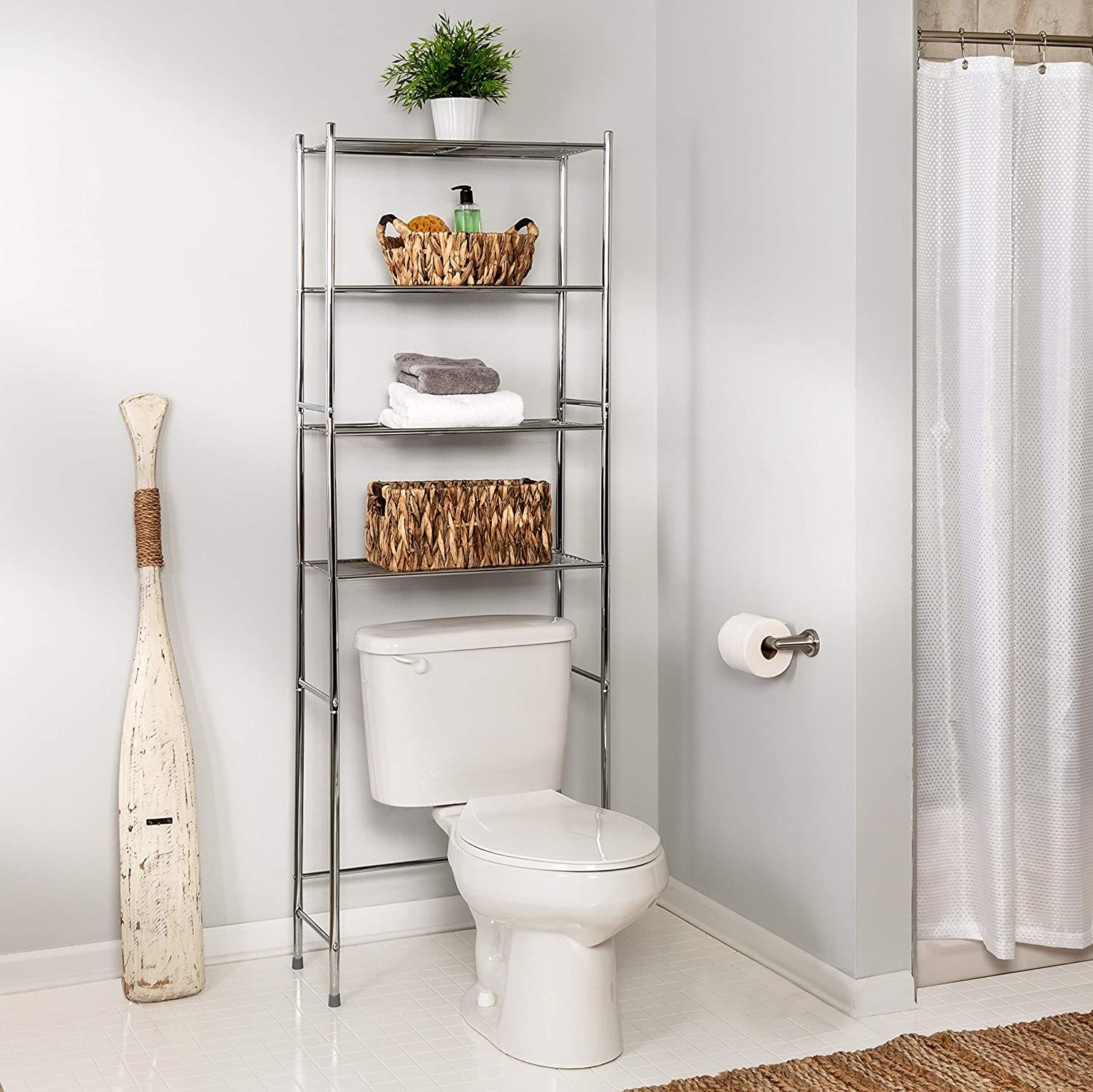 A multi-tiered shelf placed over a toilet The shelves are filled with beauty products aand toilet paper