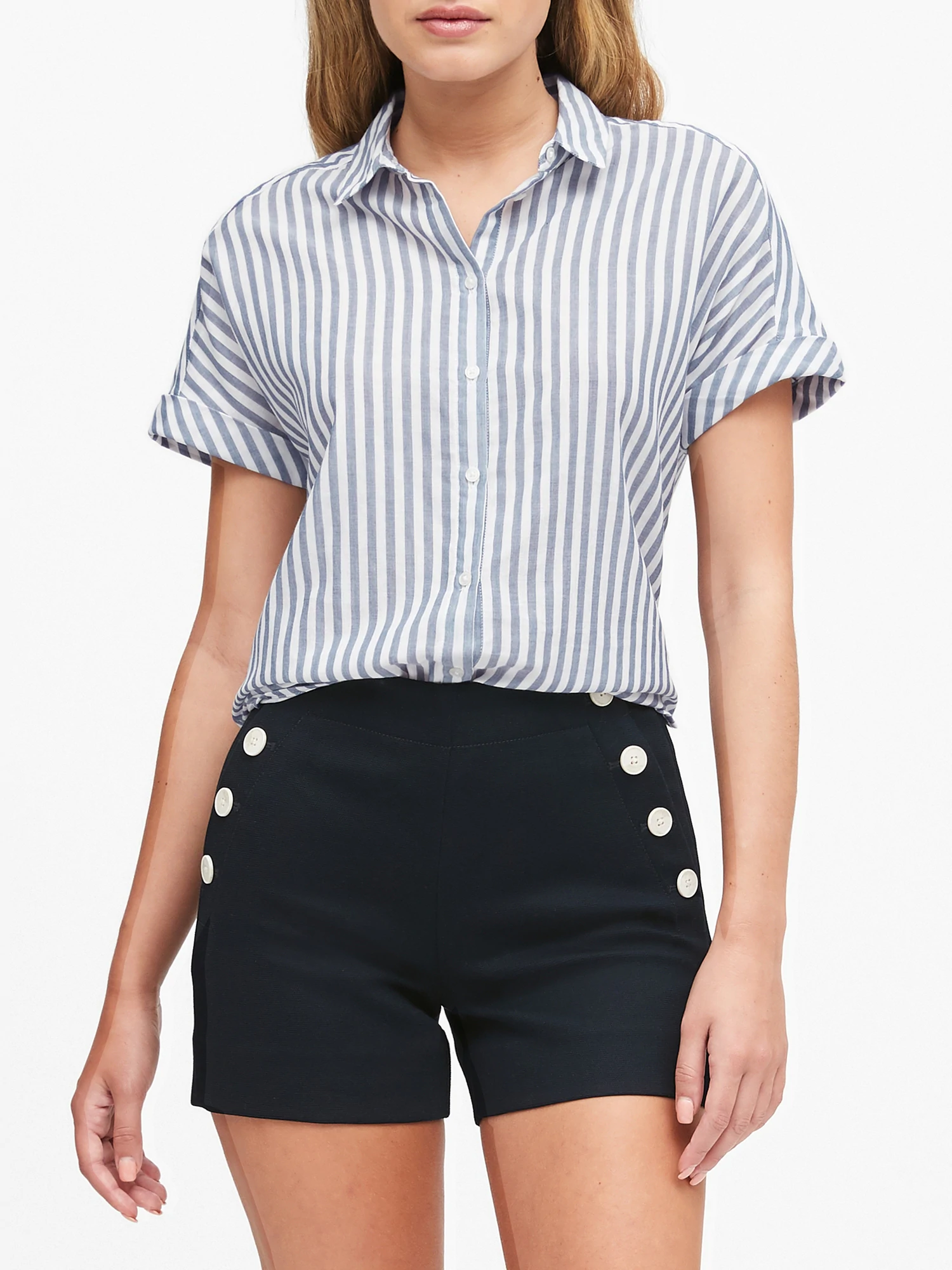 Model wearing a white and blue striped short sleeve shirt