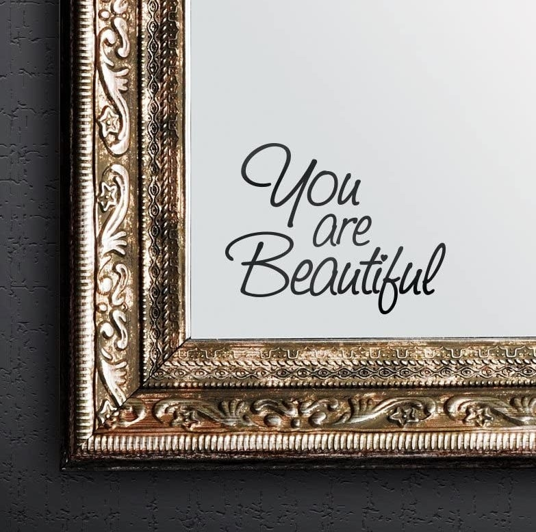 "The ""you are beautiful"" sticker on a mirror"