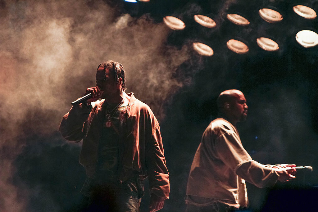 Travis Scott and Kanye West performing together on-stage at a concert