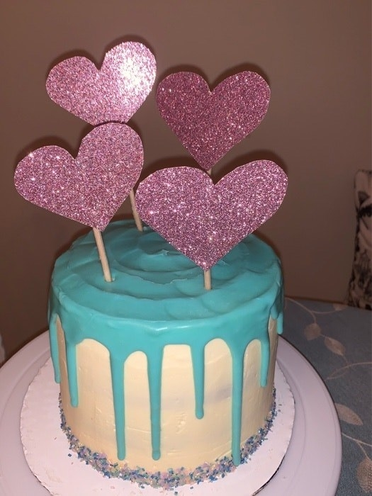 Layered cake with sparkly hearts on top