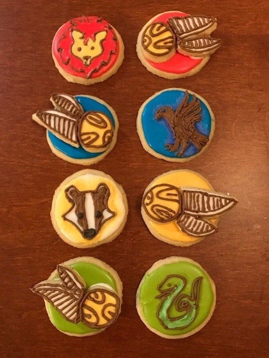 Harry Potter-themed sugar cookies, decorated to resemble each of the Hogwarts houses