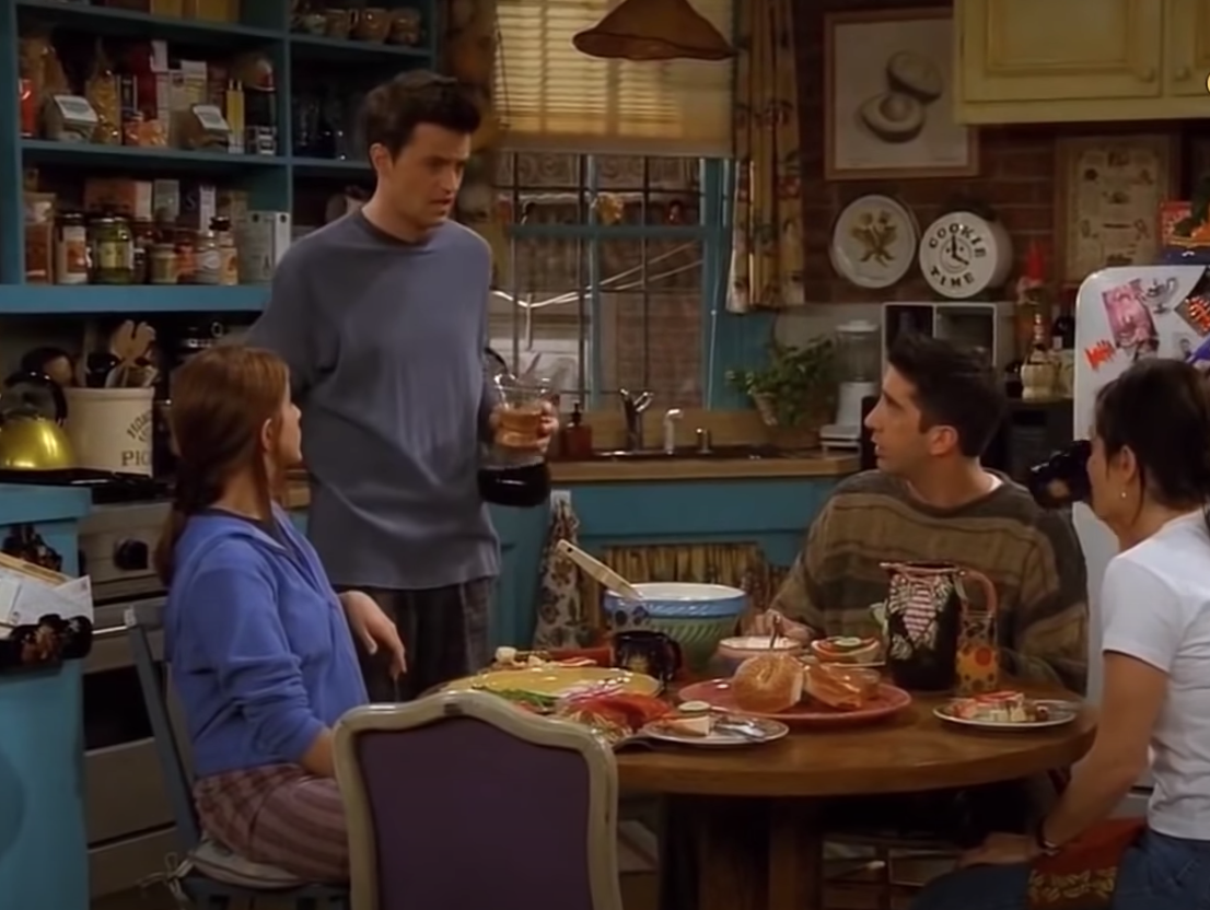 "The ""Friends"" cast sits around Monica's kitchen table."