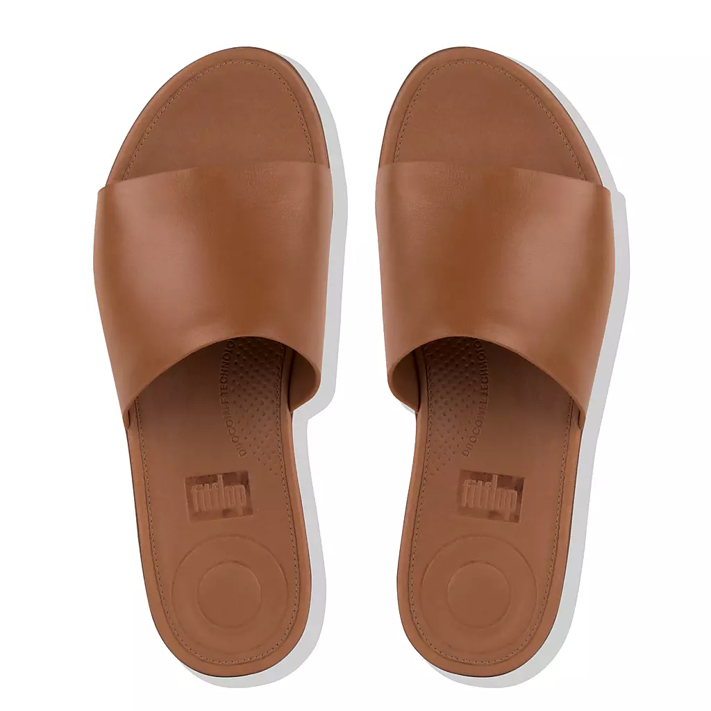 A top-down view of a pair of brown slides