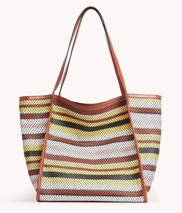 A colorful multi-striped perforated tote bag