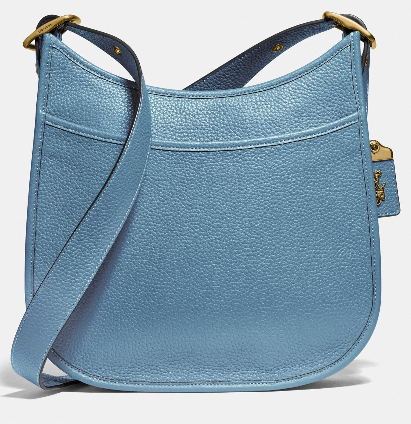 A pacific blue crossbody bag with brass buckles