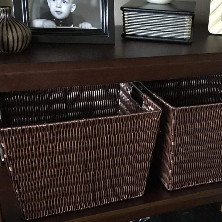 two boxes stored on a shelf