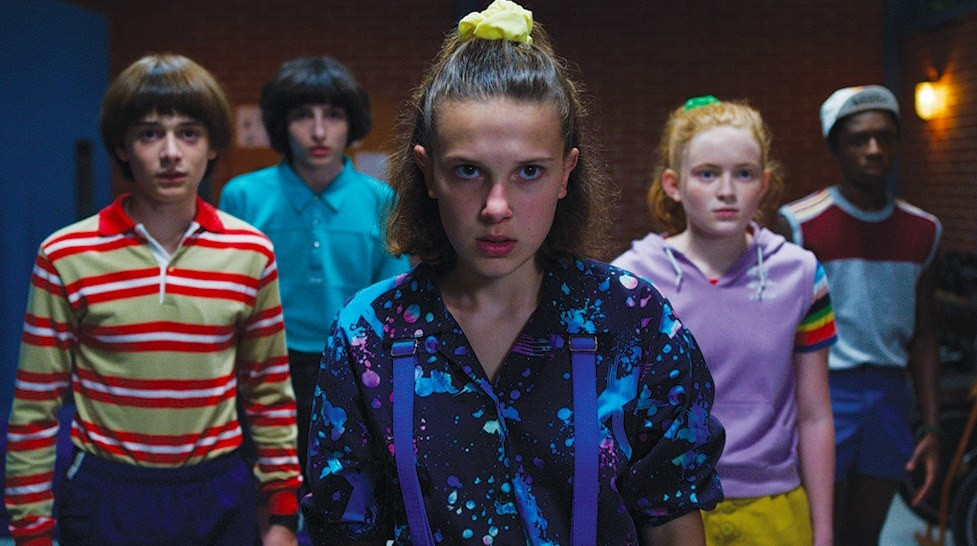 Stranger Things still: Will, Mike, Eleven, Max and Lucas stand together