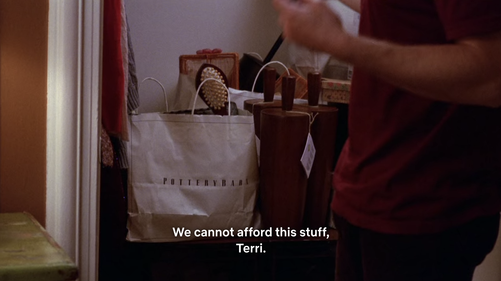 Mr. Schue opening the closet to a bunch of shopping bags