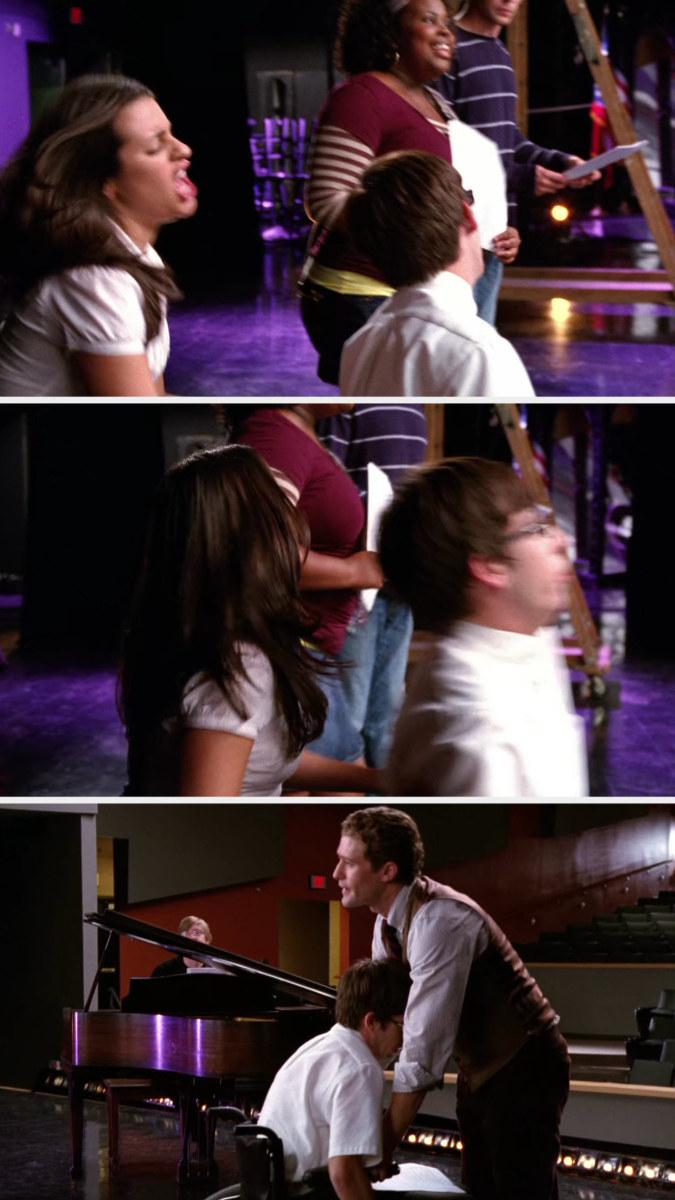 Rachel shoving Artie's wheelchair across the stage