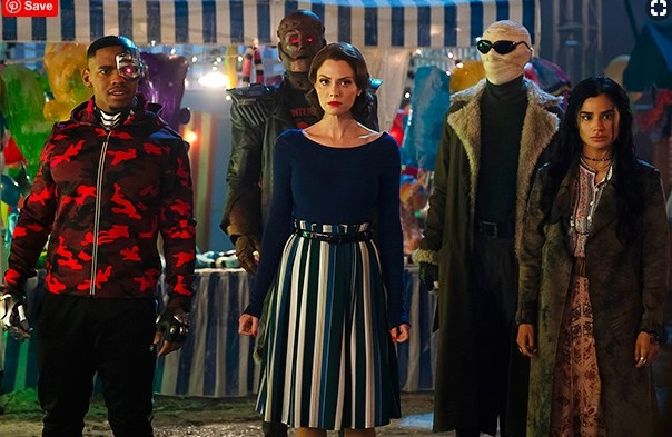Still from Doom Patrol: The Doom Patrol, a group of superheroes, stand together at a carnival