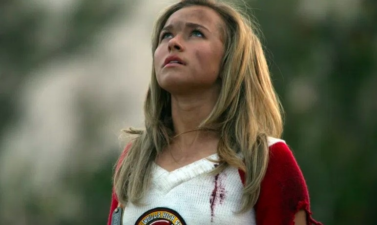 Heroes still: Claire looks up, her face dirty, wearing a bloody and torn cheerleading uniform
