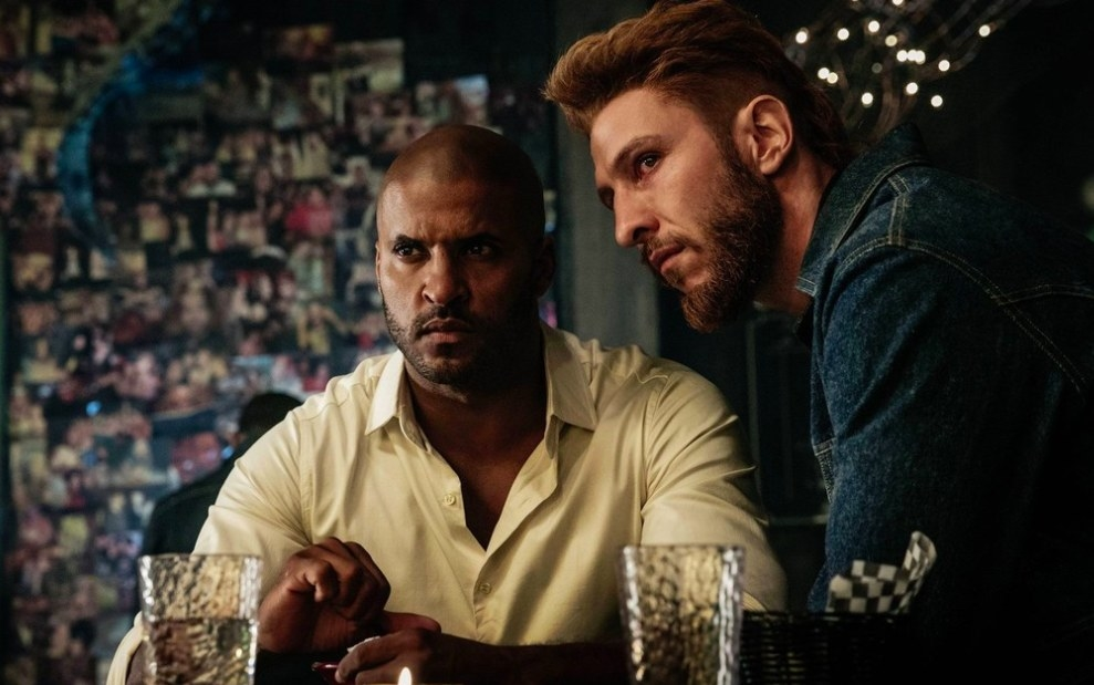 American Gods still: Shadow Moon and Mad Sweeney sit together in a bar