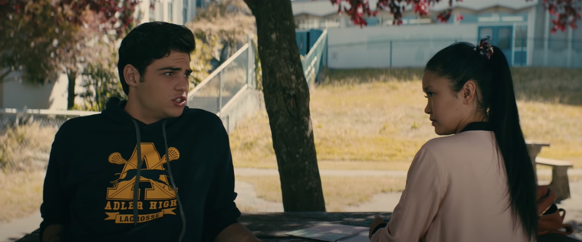 Peter and Lara Jean sign their fake relationship contract in To All The Boys I've Loved Before
