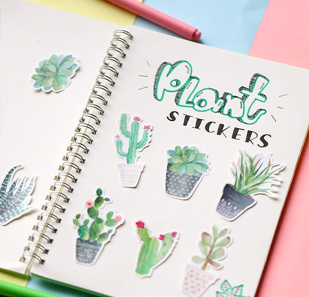 Eight plant stickers inside of a notebook