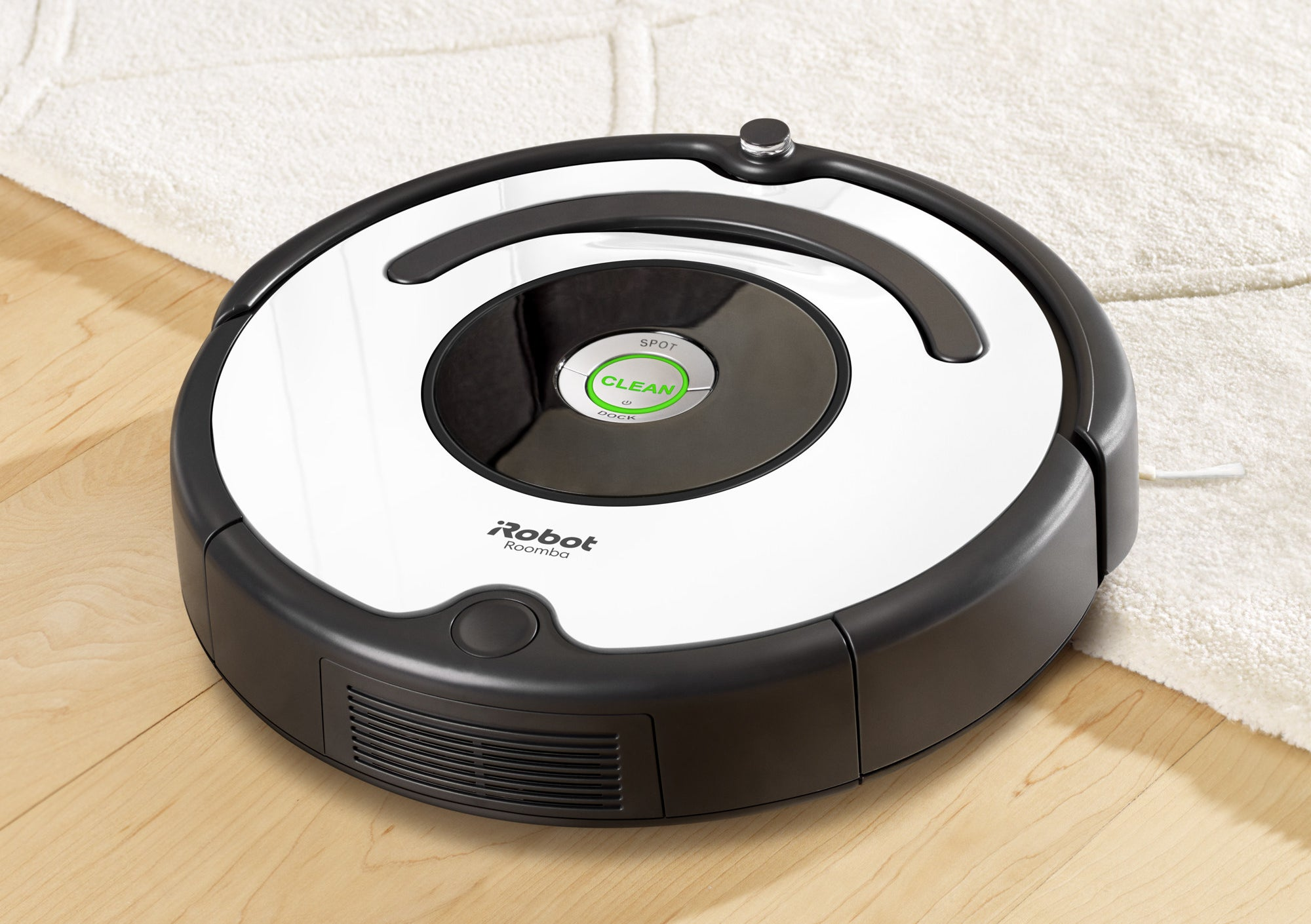 roomba vacuuming on floor